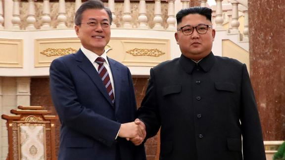 The two leaders greet each other before their summit at the headquarters of the Central Committee of the Workers' Party in Pyongyang on September 18.