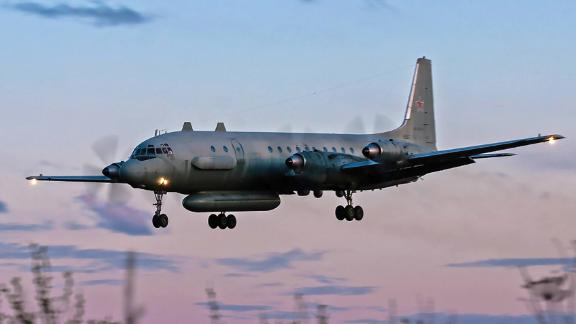 "A photo taken on July 23, 2006 shows an Russian IL-20M (Ilyushin 20m) plane landing at an unknown location. - Russia blamed Israel on September 18, 2018 for the loss of a military IL-20M jet to Syrian fire, which killed all 15 servicemen on board, and threatened a response. Israeli pilots carrying out attacks on Syrian targets ""used the Russian plane as a cover, exposing it to fire from Syrian air defences,"" a statement by the Russian military said. (Photo by Nikita SHCHYUKIN / AFP)        (Photo credit should read NIKITA SHCHYUKIN/AFP/Getty Images)"