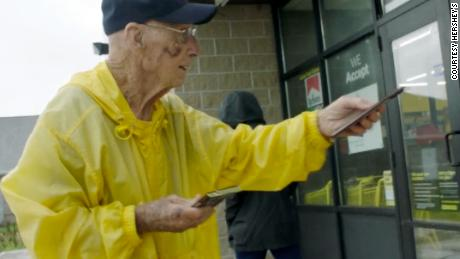 Bob Williams hands out Hershey's bars outside a Dollar General store near his home.