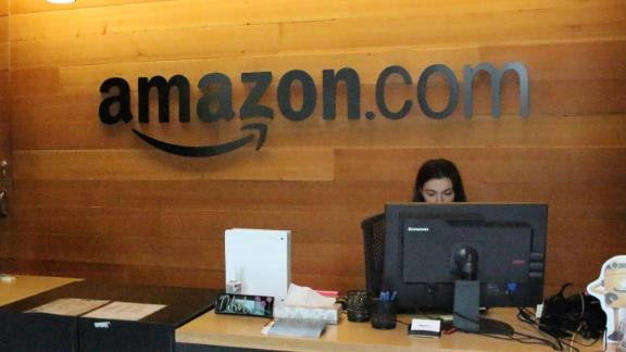 Nikol Szymul staffs a reception desk at Amazon offices discretely tucked into a building called Fiona in downtown Seattle, Washington on May 11, 2017.  Online retail powerhouse Amazon is constructing an eye-catching Spheres office building to feature waterfalls, tropical gardens and other links to nature as part of its urban campus in Seattle, Washington.  / AFP PHOTO / Glenn CHAPMAN        (Photo credit should read GLENN CHAPMAN/AFP/Getty Images)