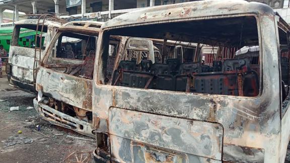 Burned buses at the terminal in Buea, the capital of a western region of Cameroon, on July 10, 2018.