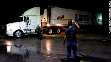 A truck carrying the corpses drives through Guadalajara.