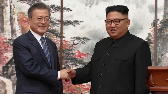 In this image made from video provided by Korea Broadcasting System (KBS), North Korean leader Kim Jong Un, right, and South Korean President Moon Jae-in shake hands at the end of their joint press conference in Pyongyang, North Korea Wednesday, September 19, 2018.