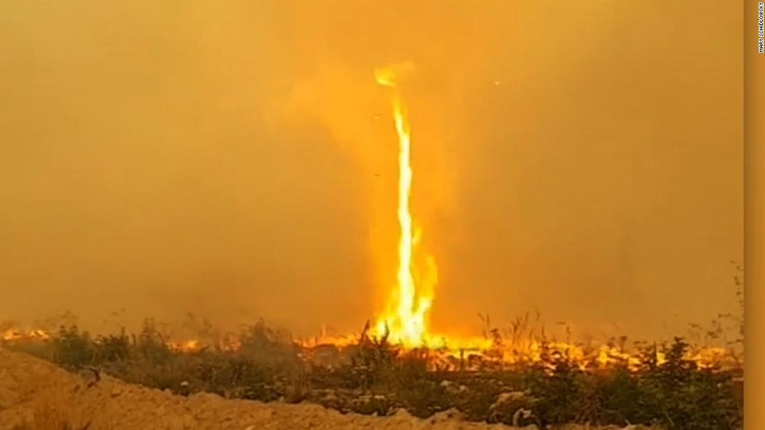 See 'firenado' snatch firefighter's hose - CNN Video