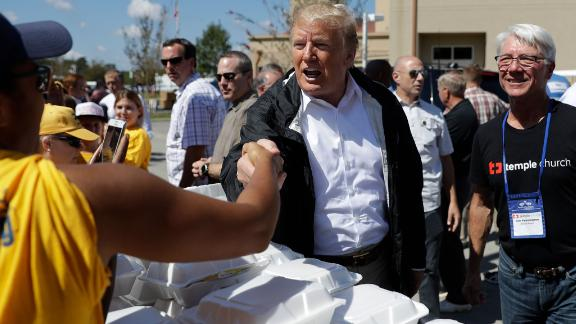 Trump shakes hands as he visits the New Bern church on Wednesday.