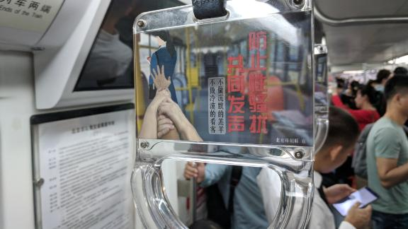 An anti-sexual harassment advertisement displayed on a handle in a Beijing subway train on September 19.