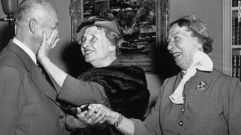 Deaf and blind American activist, writer and lecturer Helen Keller meets with Dwight Eisenhower, the 34th President of the United States.