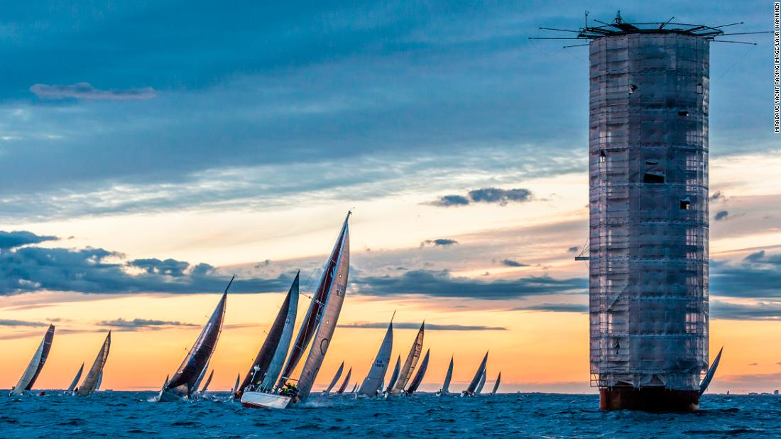 "Lauri Hänninen's shot captures the Helsinki lighthouse in the Baltic Sea during Finland's biggest off-shore sailing race. ""[The lighthouse] was under renovation and looked strangely sci-fi in the middle of light Nordic summer night,"" says Lauri."