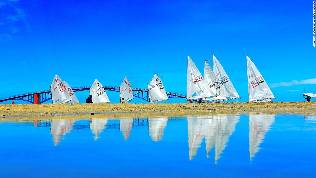 During the Taiwan Regatta on Penghu Island, Lien Shou Lin photographed sails and their reflections, as the boats gathered at the starting line.