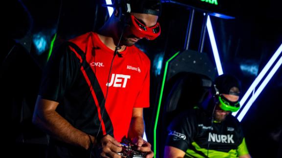 Two-time defending champions JET wears a custom headset which allows him to fly the drone from the perspective of a mounted camera.