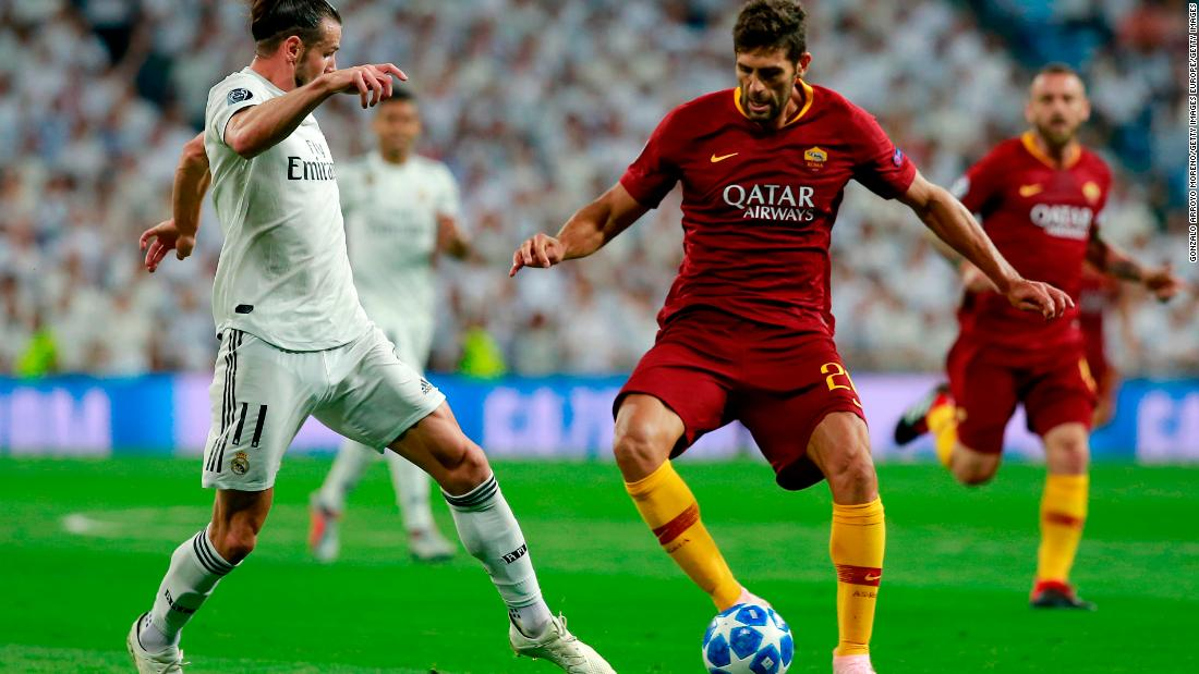Federico Fazio of AS Roma is challenged by Gareth Bale who helped Real Madrid to a 3-0 win with the second goal in the Santiago Bernabeu.