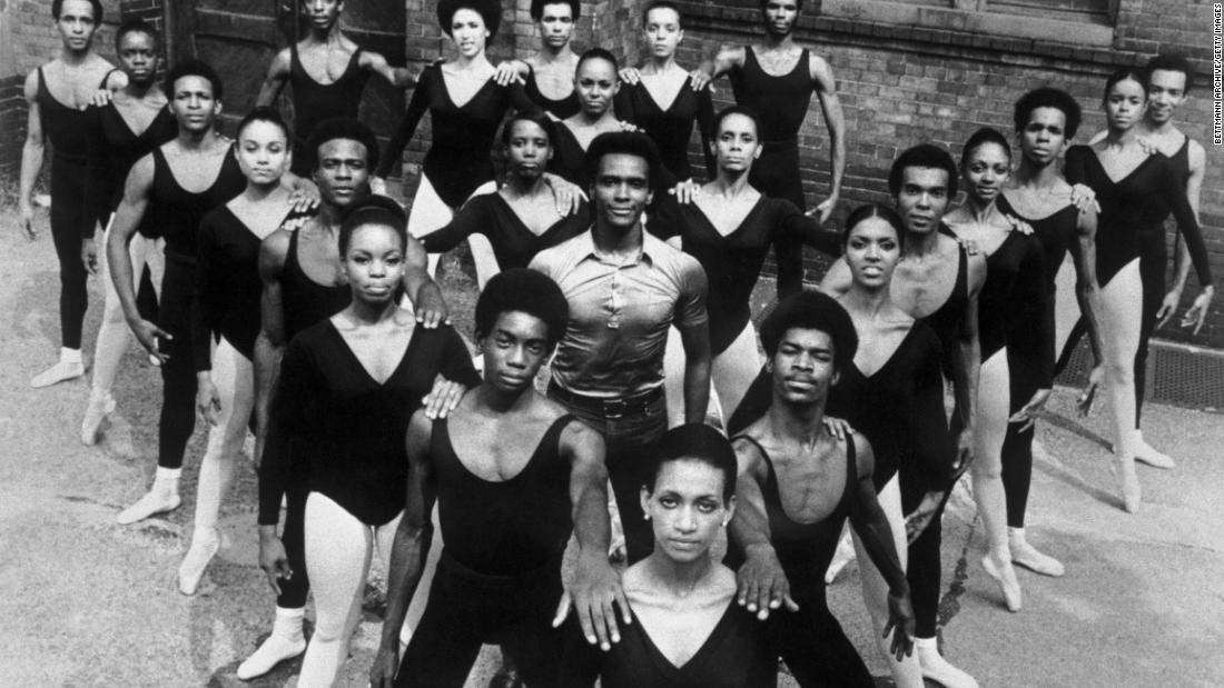 Mitchell stands in the middle of dancers of the Black Ballet Company in 1973. Revered for his artistic accomplishments, Mitchell was driven by the belief that dance can effect social change.
