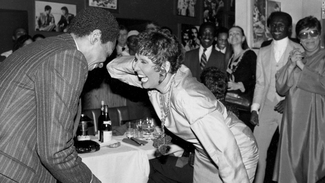 Entertainer Lena Horne dances with Mitchell at a New York restaurant as she was honored by the Dance Theatre of Harlem in 1982.