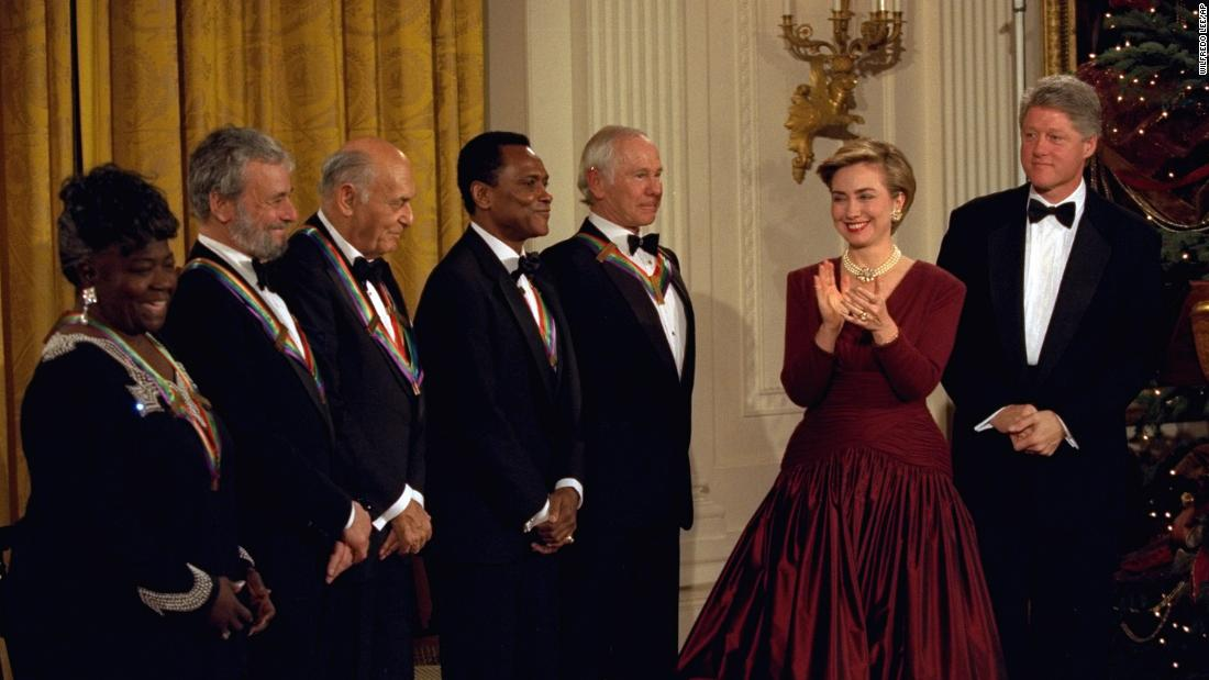 President Bill Clinton and first lady Hillary Clinton applaud the recipients of the 1993 Kennedy Center Honors, including Mitchell, in the East Room of the White House.