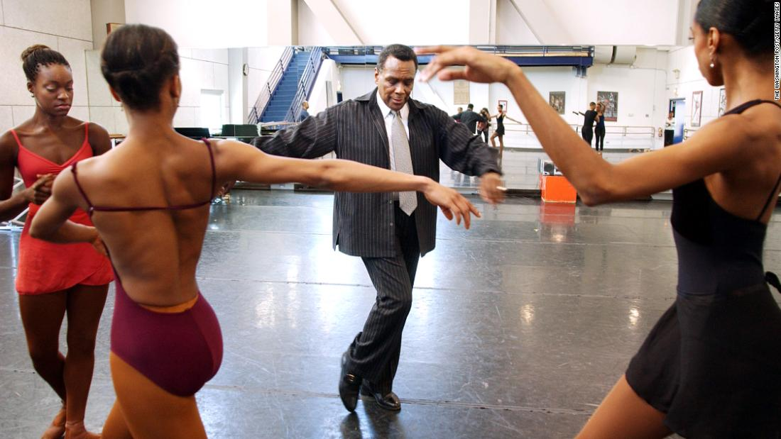 Mitchell, as artistic director of the Dance Theatre of Harlem, works with dancers in 2003. The dancers, from left, are Ebony Haswell, Amy Johnson and Rejane Duarte.