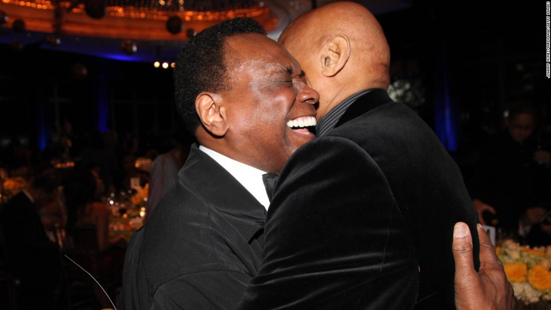 Mitchell and singer Harry Belafonte hug at a Dance Theatre of Harlem gala in 2012.