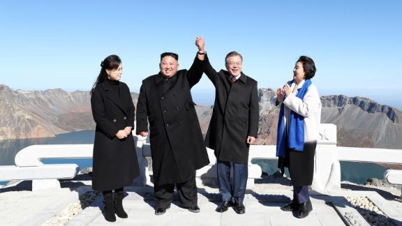 A handout photo shows South Korean President Moon Jae-in and North Korean leader Kim Jong Un visiting Mount Paektu.