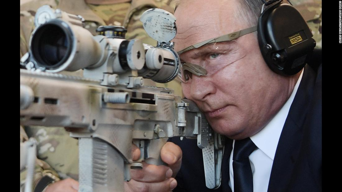 Russian President Vladimir Putin tests a new sniper rifle while visiting Patriot Park in Kubinka, Russia, on Wednesday, September 19.