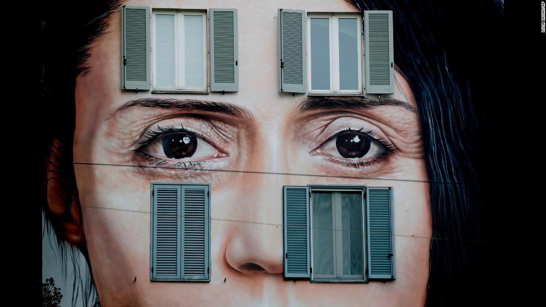 "The face of performance artist Marina Abramovic was painted on a building in Milan, Italy, to publicize an upcoming exhibition by Italian artist Maurizio Cattellan. Cattellan's exhibition, ""The Artist Is Present,"" opens in Shanghai, China, on October 10."