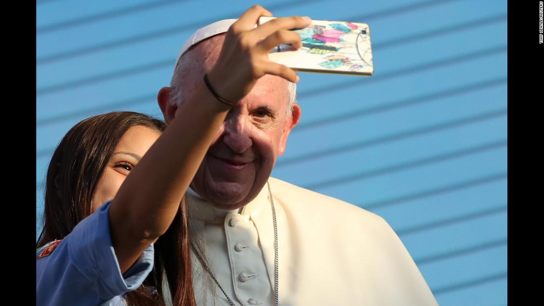 Pope Francis stops for a selfie as he meets with young people in Palermo, Italy, on Saturday, September 15.
