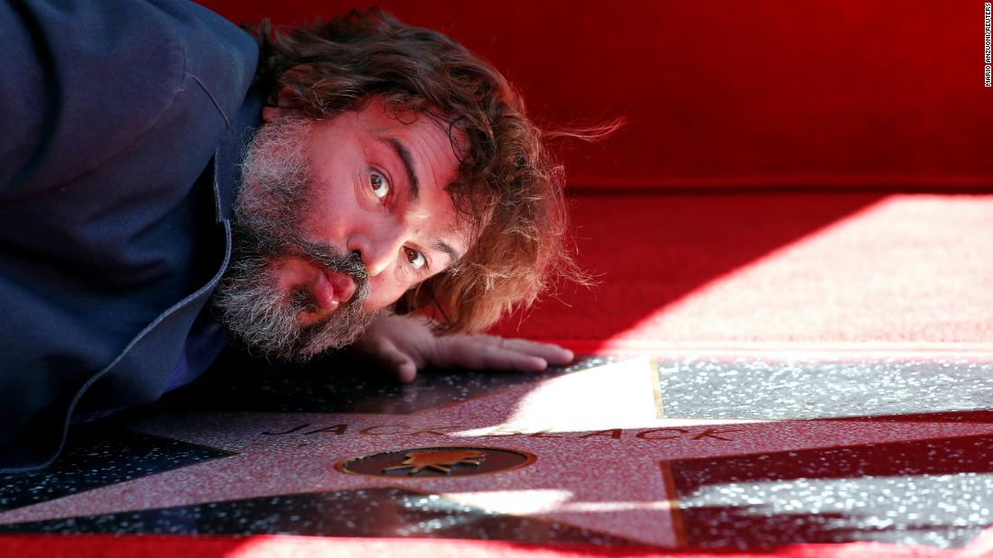 Actor Jack Black kisses his star on the Hollywood Walk of Fame after it was unveiled on Tuesday, September 18.