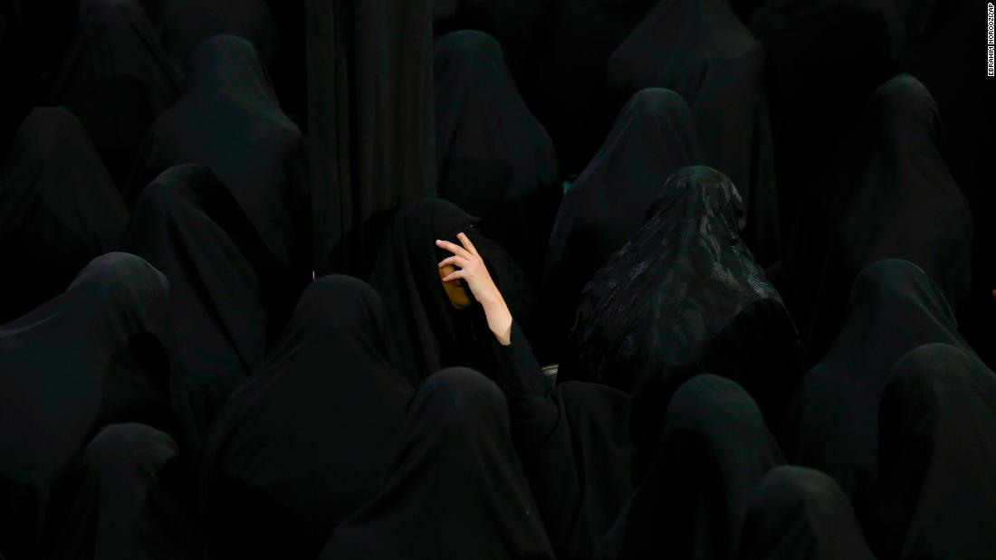 Women observe the Muslim holy day of Ashura at a mosque in Tehran, Iran, on Thursday, September 20.
