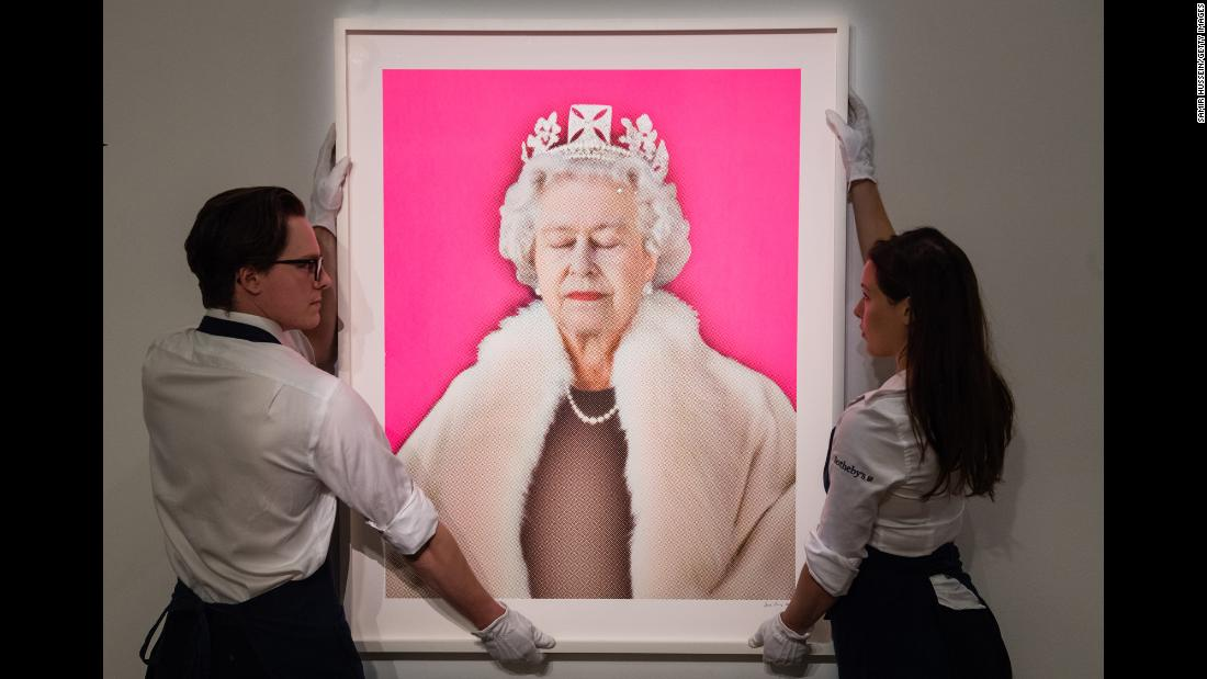 "A 2015 edition of Chris Levine's ""Lightness of Being (Pink),"" which depicts Britain's Queen Elizabeth II with her eyes closed, is displayed at an auction in London on Tuesday, September 18. The portrait, a multicolored silkscreen with hand-applied Swarovski crystals, was expected to fetch up to £100,000 (about $130,000)."