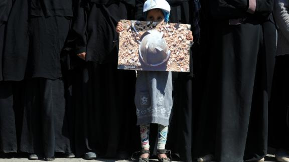 SANA'A, YEMEN -- DECEMBER 21: A girl holds a picture of a part of a missile during a rally staged against the ongoing 1000-day war on Yemen by the Saudi-led coalition outside the United Nations Office on December 21, 2017 in Sana'a, Yemen. (Photo by Mohammed Hamoud/Getty Images)