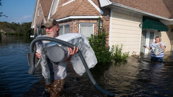 LONGS, SC - SEPTEMBER 20: James Spencer helps a friend remove valuables from their home as floodwaters caused by Hurricane Florence rise at Aberdeen Country Club on September 20, 2018 in Longs, South Carolina. Floodwaters are expected to rise through the weekend in the area. (Photo by Sean Rayford/Getty Images)