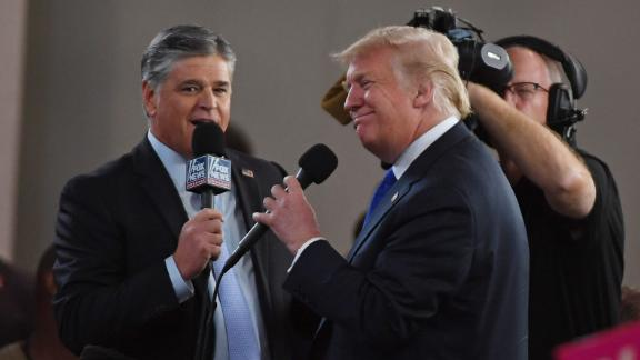 LAS VEGAS, NV - SEPTEMBER 20:  Fox News Channel and radio talk show host Sean Hannity (L) interviews US President Donald Trump before a campaign rally at the Las Vegas Convention Center on September 20, 2018, in Las Vegas, Nevada.