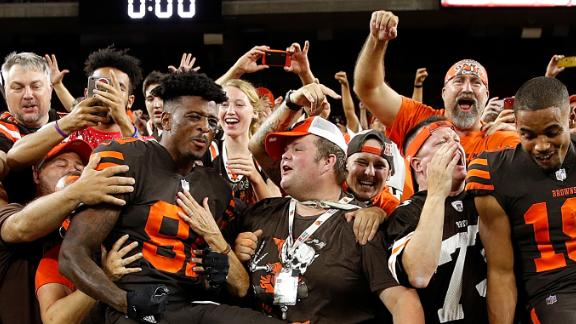 Cleveland Browns' players celebrate with their fans after Thursday's win.