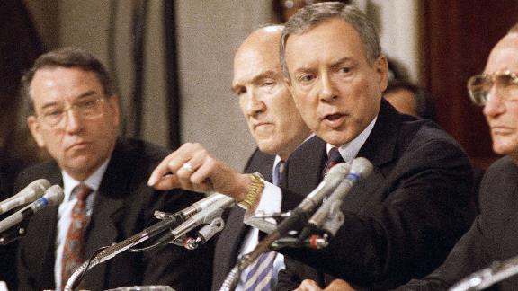 Sen. Orrin Hatch, R-Utah, questions Professor Anita Hill on Friday, Oct. 11, 1991 in Washington during a Senate Judiciary Committee hearing on the nomination of Clarence Thomas to the Supreme Court. Sen. Alan Simpson, R-Wyo., looks on. (AP Photo/John Duricka)