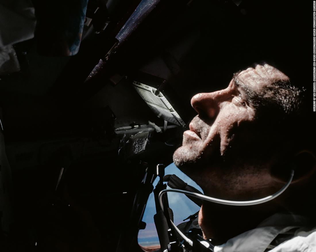 79998406b329 Astronaut Walt Cunningham looks out of the Command Module window during  Apollo 7  39