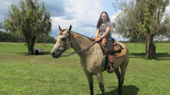 Thomas still rides her horse Shadow, but she needs assistance getting on. Her goal is to be able to saddle Shadow herself and hop on with no help.