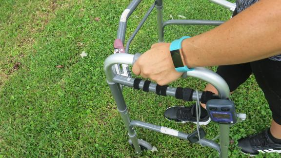Thomas uses a walker with front wheels. She says her top goal now is ditch the walker one day.