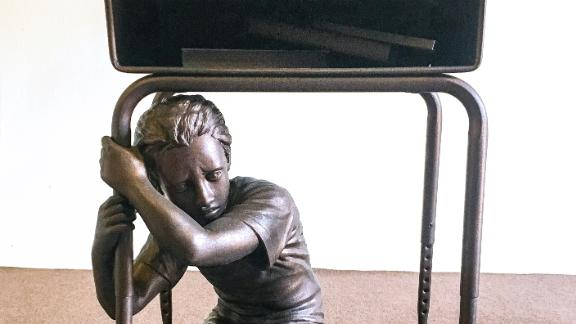 A bronze-coated statue based on the Parkland shooting has a message for voters.