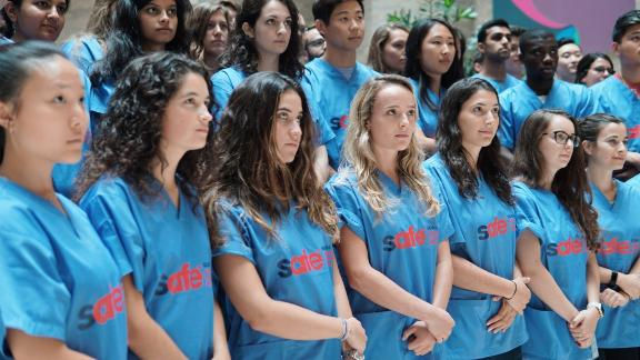 """Medical students at the Icahn School of Medicine at Mount Sinai held a demonstration last week against gun violence, wearing custom scrubs that featured a bullet hole in the word """"safe."""""""
