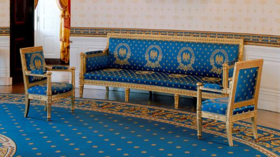 This sofa and armchair set of gilded beechwood by Pierre-Antoine Bellange of Paris were purchased during the James Monroe administration for the Blue Room.