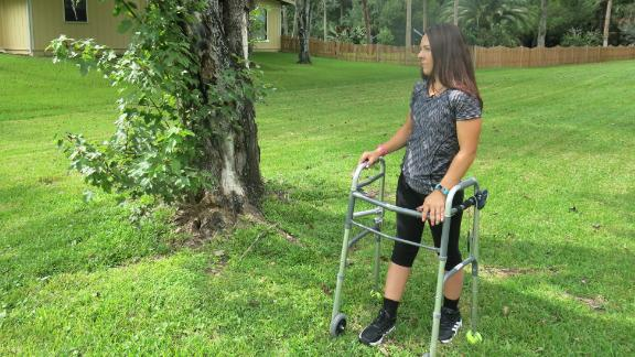 """Thomas stands next to the red maple where the truck she was driving came to a halt. """"The stimulator is facilitating my movement,"""" she says, """"but my strength is coming from within."""""""
