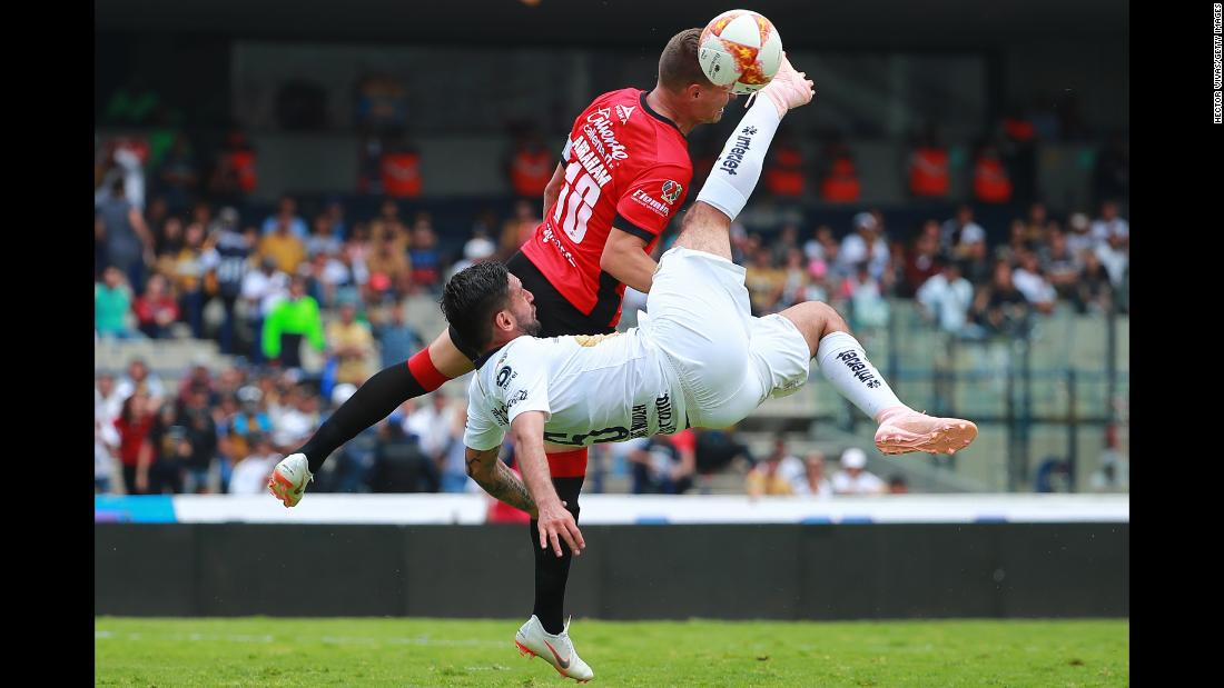 Alan Mendoza of Pumas UNAM struggles for the ball with Abraham Gonzalez of Lobos BUAP during their match in the Torneo Apertura Liga MX on Sunday, September 16, in Mexico City. Pumas won 4-2.