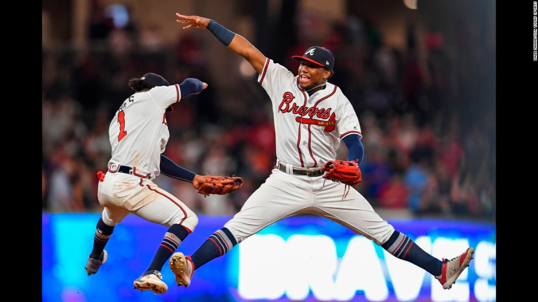 Ozzie Albies and Ronald Acuna Jr. of the Atlanta Braves celebrate after defeating the Philadelphia Phillies on Friday, September 21, in Atlanta.