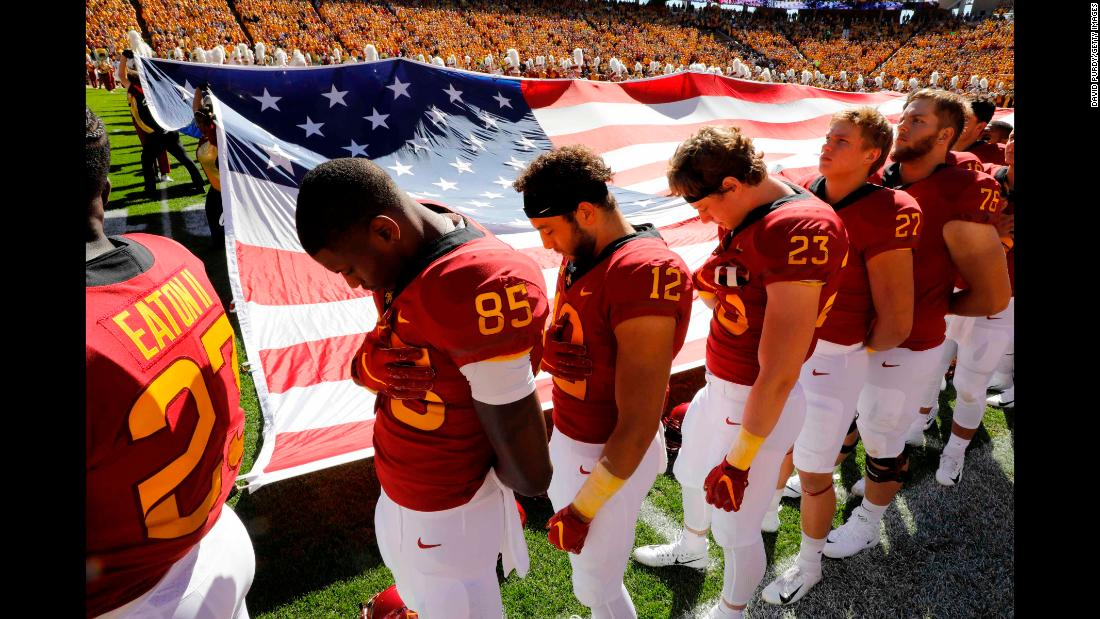 After a pregame moment of silence to honor Celia Barquin Arozamena, members of the Iowa State Cyclones bow their heads during the National Anthem on Saturday, September 22, in Ames, Iowa. Barquin Arozamena, an accomplished student-athlete at Iowa State, was found dead September 17 after she was assaulted, officials said.