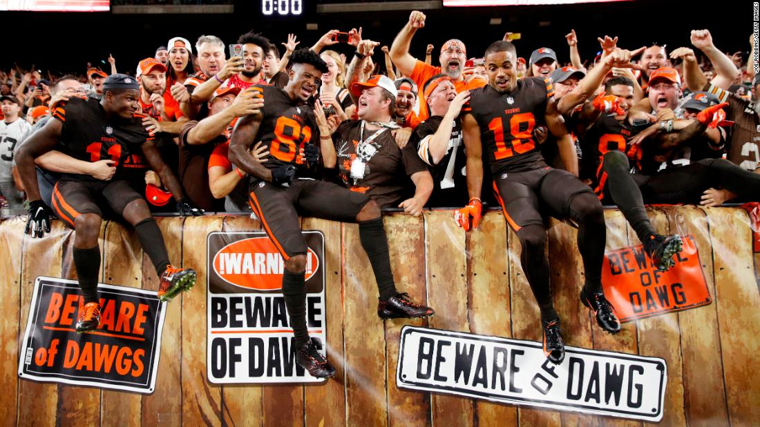 Cleveland Browns players celebrate with fans after winning the game against the New York Jets on Thursday, September 20, in Cleveland. The Browns won 21-17.