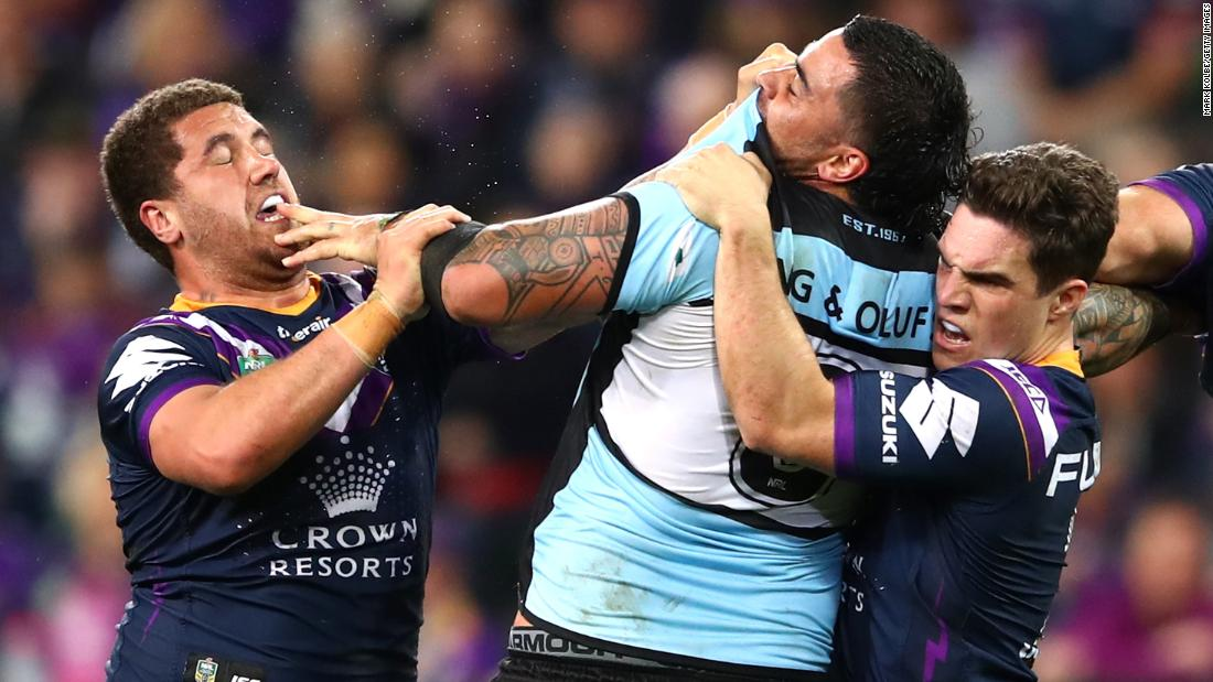 Kenny Bromwich of the Melbourne Storm and Andrew Fifita of the Cronulla Sharks have an altercation during the NRL Preliminary Final match on Friday, September 21, in Melbourne.