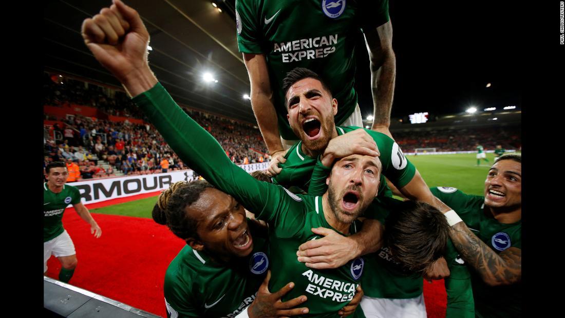 Glenn Murray of Brighton and Hove Albion celebrates with his teammates after scoring their second goal against Southampton on Monday, September 17, in Southampton, England.