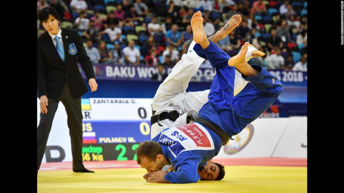 Mikhail Puliaev fights against Georgii Zantaraia at the Judo World Championships in Baku, Azerbaijan, on Friday, September 21.