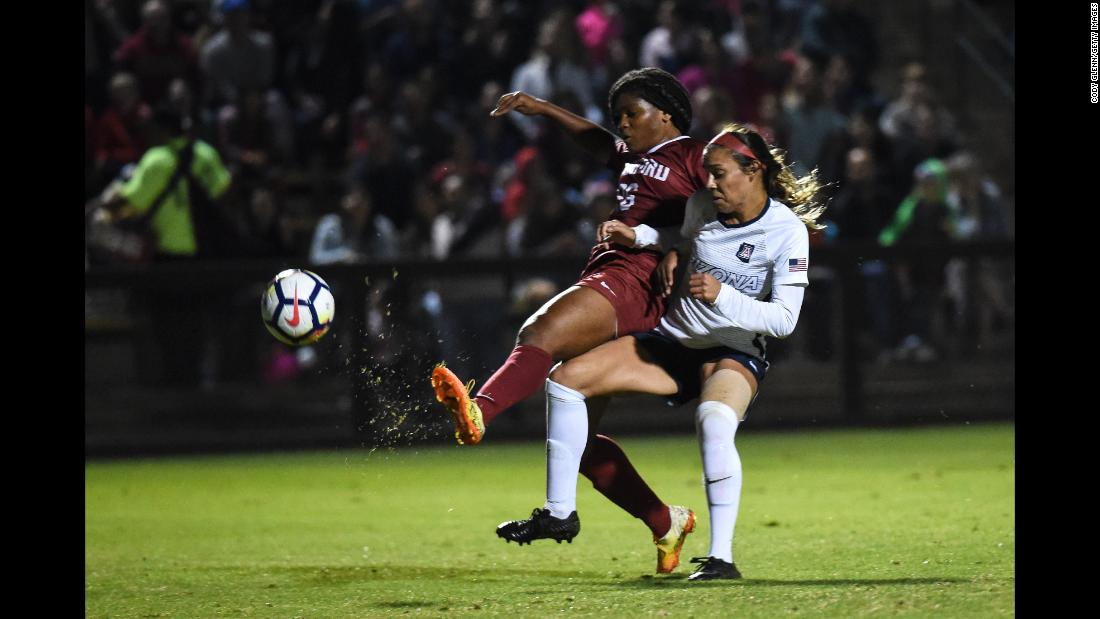 Madison Haley of Stanford University fights for the ball with Sabrina Enciso of The University of Arizona in the women's soccer match Friday, September 21, in Stanford, California.