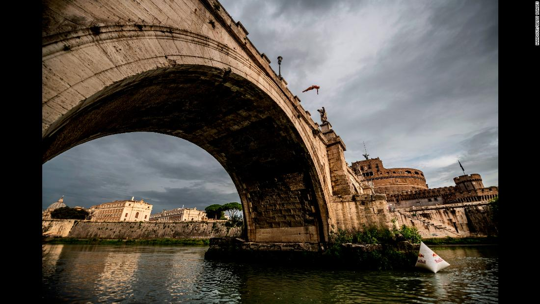 "Rhiannan Iffland of Australia dives from the Sant'Angelo Bridge over the Tiber River while traveling to Polignano a Mare for the final stop of the Red Bull Cliff Diving World Series on Wednesday, September 19, in Rome. <a href=""https://www.cnn.com/2018/09/16/sport/gallery/what-a-shot-sports-0916/index.html"" target=""_blank"">See 36 amazing sports photos from last week.</a>"