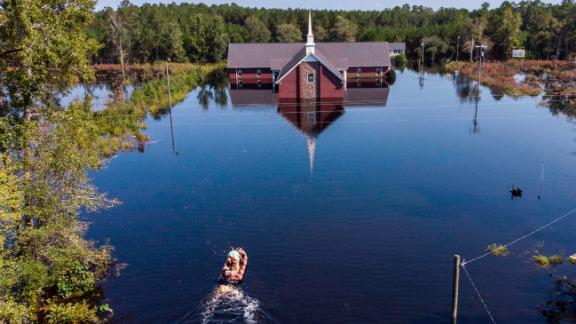 Avery Singleton takes a boat to Pine Grove Baptist Church in Brittons Neck, South Carolina, on Saturday.
