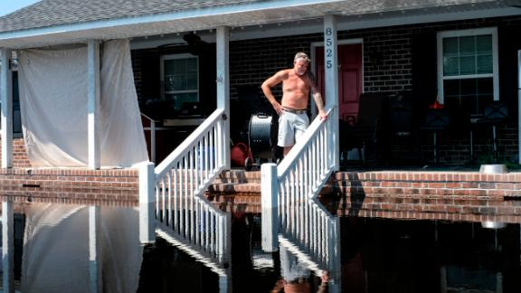 Brian Terry looks at the floodwaters outside his home in Brittons Neck, South Carolina, on Saturday, September 22.
